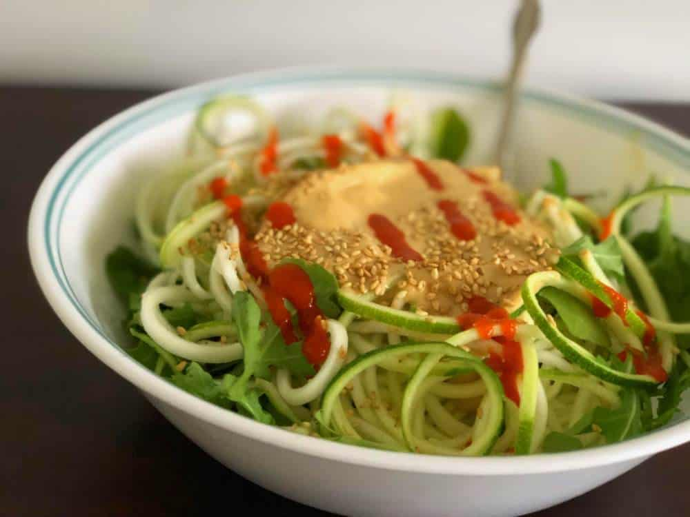 final presentation of zucchini ginger zoodles from the side