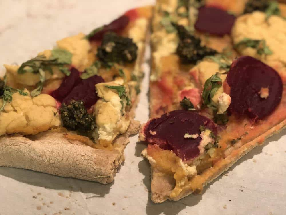 sweet potato basil pesto pizza after being baked