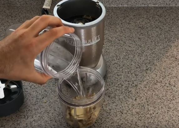 pouring water over ginger