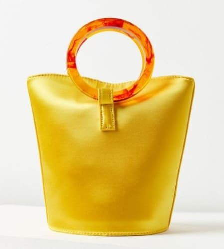 ROSE CIRCLE HANDLE YELLOW BUCKET BAG FROM URBAN OUTFITTERS