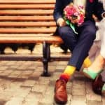 wearing vegan wedding shoes on bench