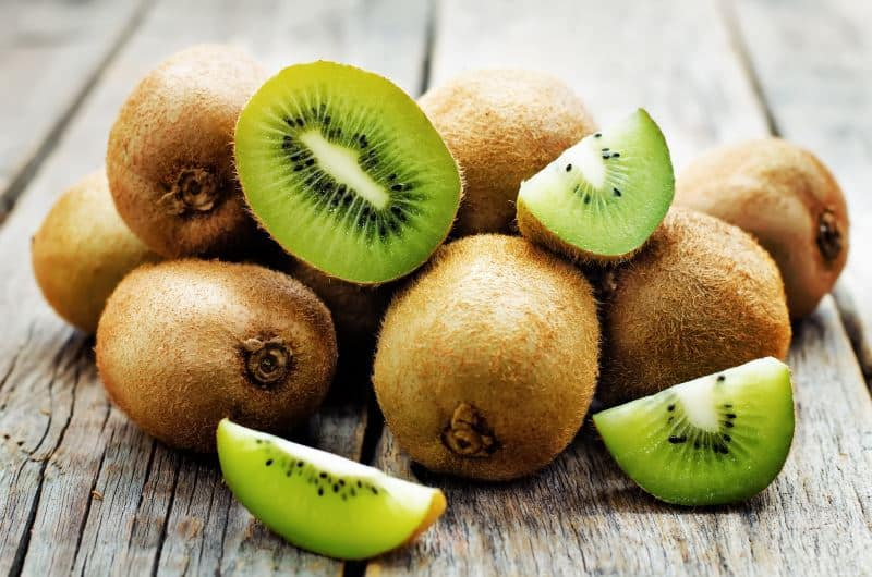 kiwis sliced open on a table