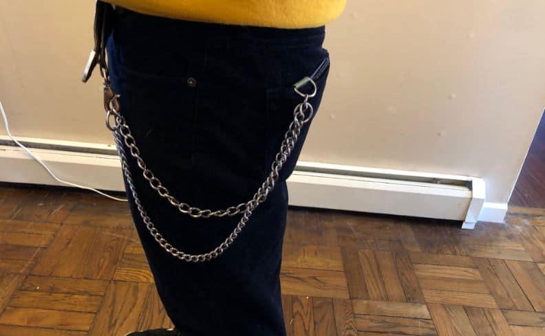 man wearing vegan chain wallet