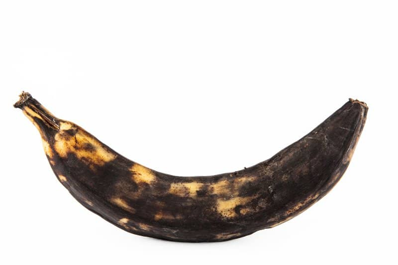 picture of a ripe plantain with black and heavily spotted skin