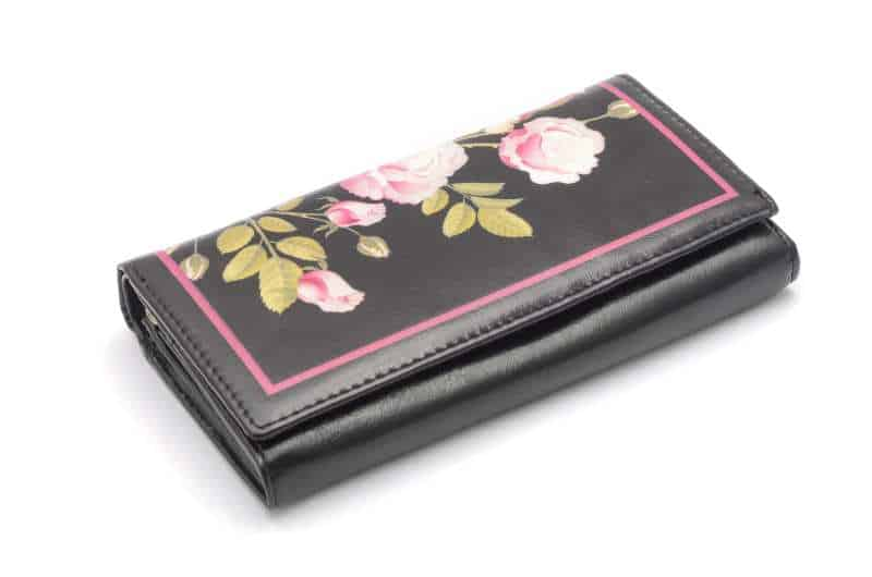 vegan clutch wallet with flowers on white background