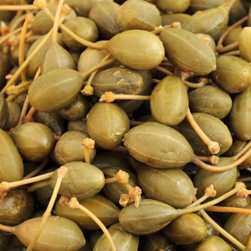 caper berries as background