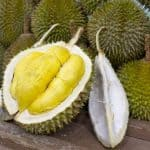 Durian open in display with yellow flesh on fruit stand in tropical country 2