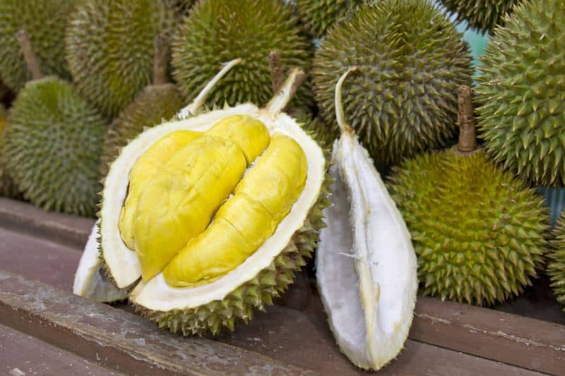 open durian with inside flesh showing