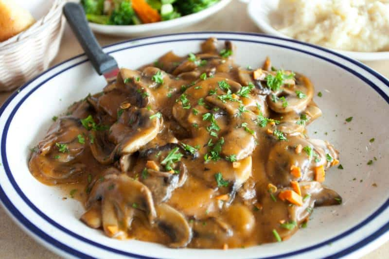 Marsala Sauce on a place with mushrooms and parsley