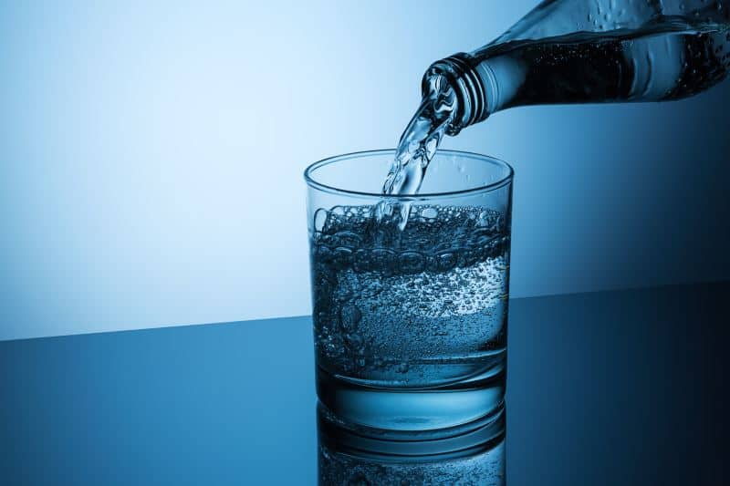 Mineral Water being poured from the bottle
