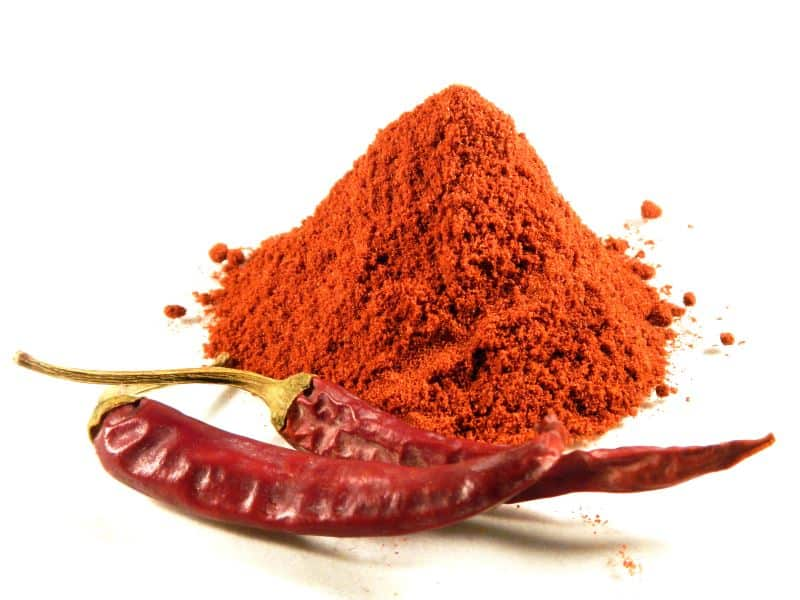 ground paprika with a pepper on the side