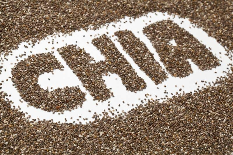 Chia seeds with the word chia spelled out in chia seeds in the middle.