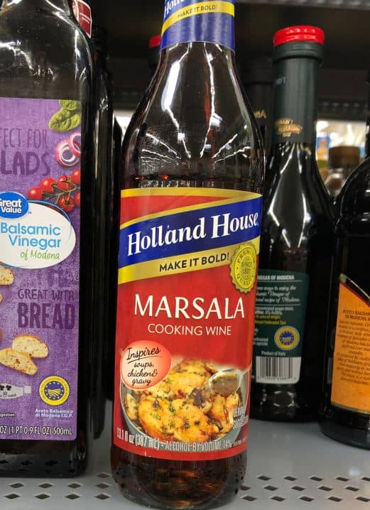 A bottle of Holland House Marsala Cooking Wine on a supermarket shelf.