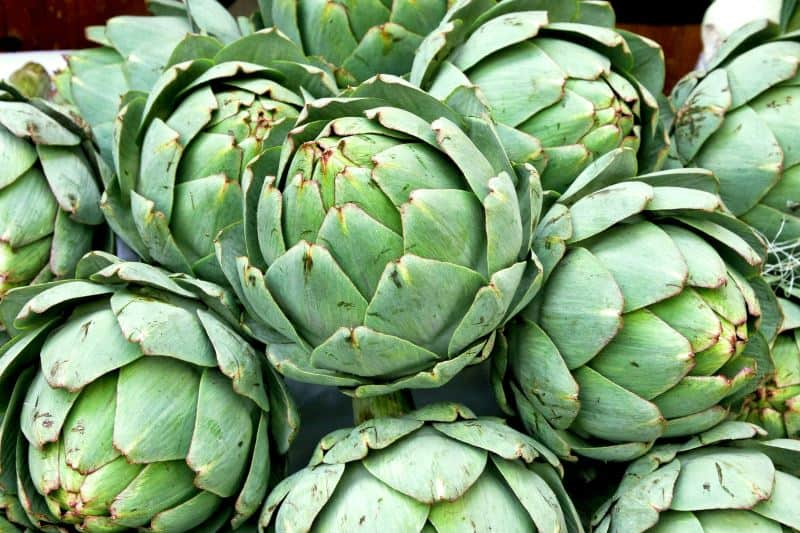 Fresh whole artichokes at the market