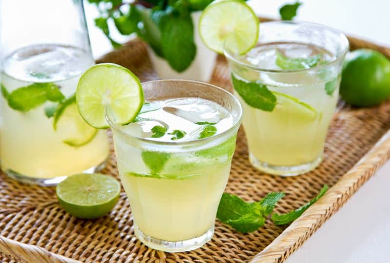 Glasses of key lime juice with ice and mint