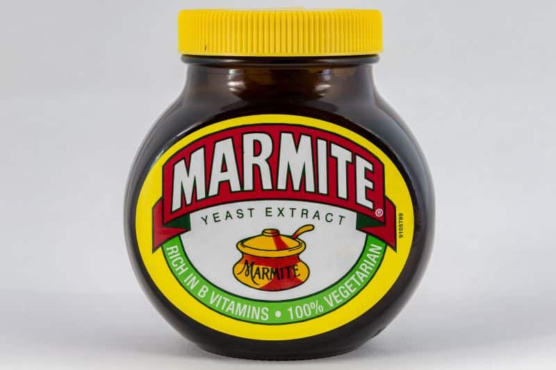 A jar of Marmite against a white background.