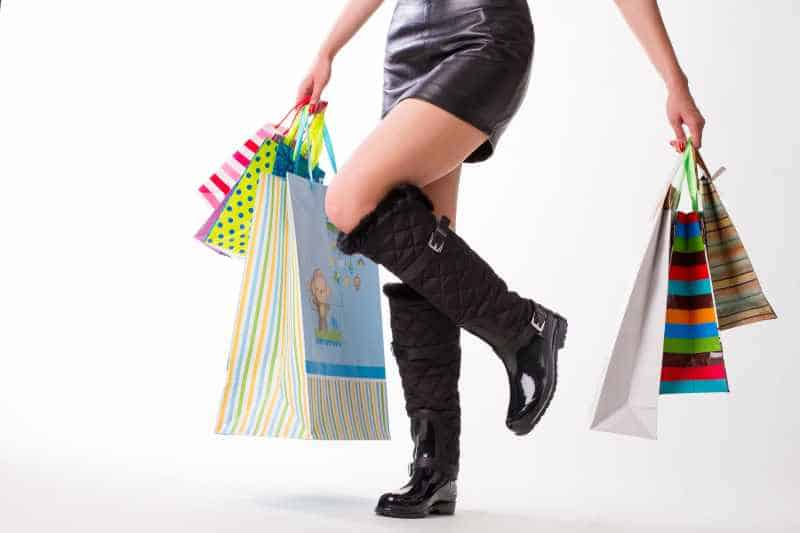 woman shopping in vegan leather skirt