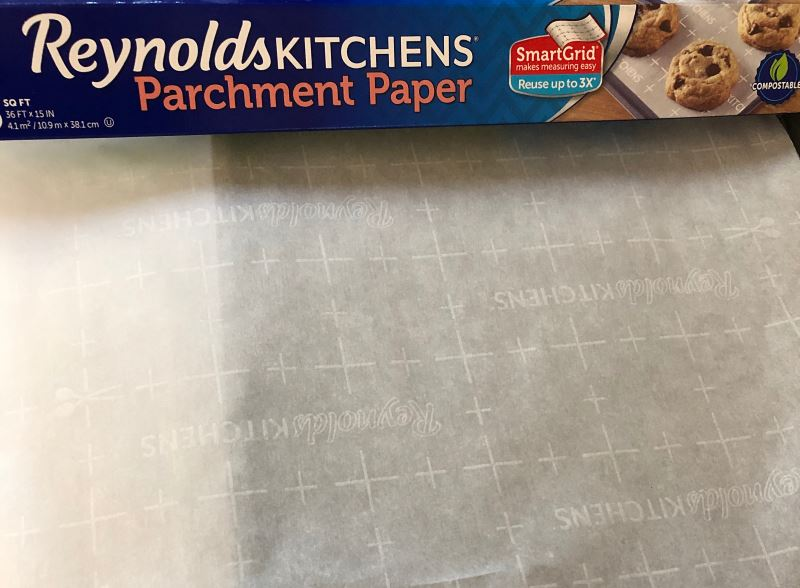 Reynolds Kitchens parchment paper unrolled on a counter