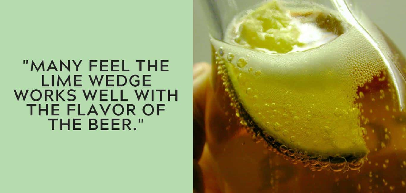 """Many feel the lime wedge works well with the flavor of the beer."""