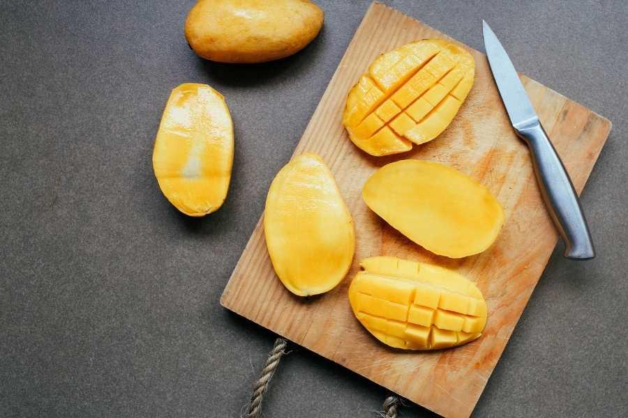 Mangoes on chopping board